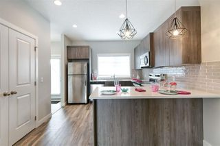 Photo 15: 219 GRIESBACH Road in Edmonton: Zone 27 House Half Duplex for sale : MLS®# E4192905