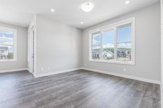 Photo 7: 137 Crestridge Common SW in Calgary: Crestmont Row/Townhouse for sale : MLS®# A1048109