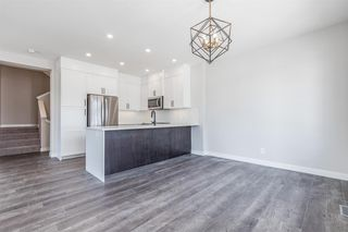 Photo 6: 137 Crestridge Common SW in Calgary: Crestmont Row/Townhouse for sale : MLS®# A1048109