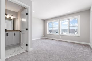 Photo 11: 137 Crestridge Common SW in Calgary: Crestmont Row/Townhouse for sale : MLS®# A1048109