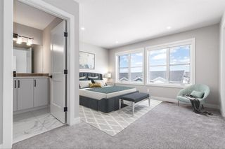 Photo 10: 137 Crestridge Common SW in Calgary: Crestmont Row/Townhouse for sale : MLS®# A1048109