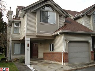 "Photo 1: 409 13900 HYLAND Road in Surrey: East Newton Townhouse for sale in ""HYLAND GROVE"" : MLS®# F1103639"