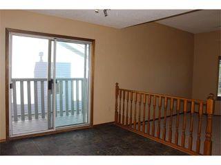 Photo 6: 36 ERIN MEADOW Way SE in Calgary: Erinwoods House for sale : MLS®# C4022030