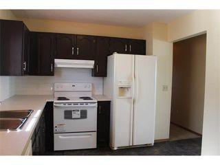 Photo 4: 36 ERIN MEADOW Way SE in Calgary: Erinwoods House for sale : MLS®# C4022030