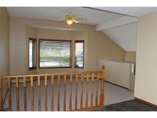 Photo 8: 36 ERIN MEADOW Way SE in Calgary: Erinwoods House for sale : MLS®# C4022030