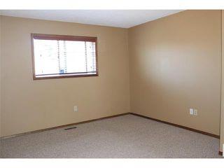 Photo 11: 36 ERIN MEADOW Way SE in Calgary: Erinwoods House for sale : MLS®# C4022030