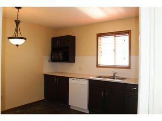 Photo 5: 36 ERIN MEADOW Way SE in Calgary: Erinwoods House for sale : MLS®# C4022030