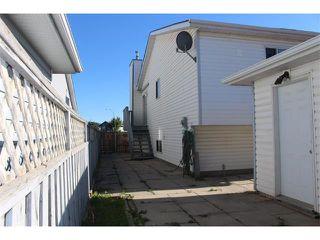 Photo 15: 36 ERIN MEADOW Way SE in Calgary: Erinwoods House for sale : MLS®# C4022030