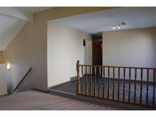 Photo 7: 36 ERIN MEADOW Way SE in Calgary: Erinwoods House for sale : MLS®# C4022030