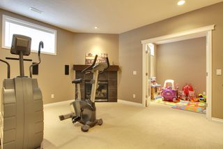 Photo 16: 131 Cougar Plateau Circle SW in Calgary: 2 Storey for sale : MLS®# C3614218