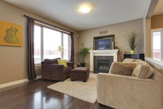 Photo 6: 131 Cougar Plateau Circle SW in Calgary: 2 Storey for sale : MLS®# C3614218