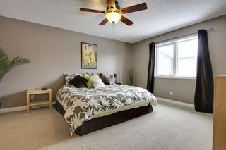 Photo 11: 131 Cougar Plateau Circle SW in Calgary: 2 Storey for sale : MLS®# C3614218