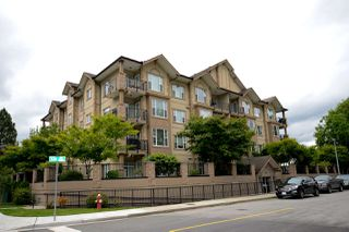 "Photo 1: 408 20286 53A Avenue in Langley: Langley City Condo for sale in ""CASA VERONA"" : MLS®# R2177236"