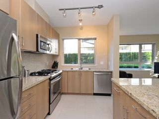 "Photo 2: 104 701 KLAHANIE Drive in Port Moody: Port Moody Centre Condo for sale in ""Nahanni"" : MLS®# R2209103"