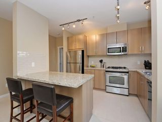 "Photo 3: 104 701 KLAHANIE Drive in Port Moody: Port Moody Centre Condo for sale in ""Nahanni"" : MLS®# R2209103"