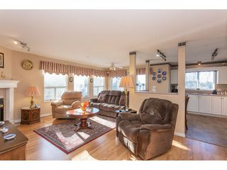 "Photo 2: 405 33708 KING Road in Abbotsford: Poplar Condo for sale in ""Collage Park"" : MLS®# R2323684"
