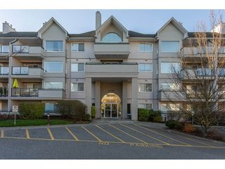 "Photo 1: 405 33708 KING Road in Abbotsford: Poplar Condo for sale in ""Collage Park"" : MLS®# R2323684"