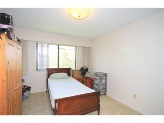 "Photo 5: 207 6904 FRASER Street in Vancouver: South Vancouver Condo for sale in ""CASA BLANCA"" (Vancouver East)  : MLS®# V1037188"