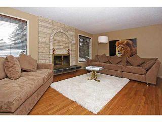 Photo 9: 116 LAKE PLACID Road SE in Calgary: Lk Bonavista Estates Residential Detached Single Family for sale : MLS®# C3654638