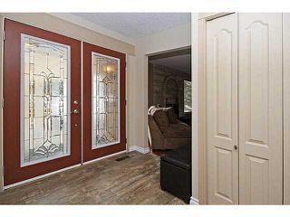 Photo 2: 116 LAKE PLACID Road SE in Calgary: Lk Bonavista Estates Residential Detached Single Family for sale : MLS®# C3654638
