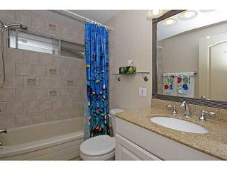 Photo 18: 116 LAKE PLACID Road SE in Calgary: Lk Bonavista Estates Residential Detached Single Family for sale : MLS®# C3654638