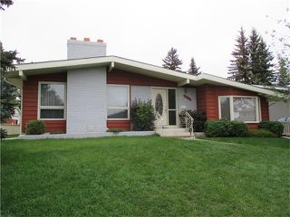 Photo 1: 5735 LADBROOKE Drive SW in Calgary: Lakeview House for sale : MLS®# C4031182