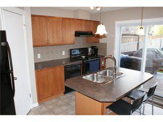 Photo 2: 163 AUBURN BAY Heights SE in Calgary: Auburn Bay House  : MLS®# C4035623