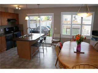 Photo 4: 163 AUBURN BAY Heights SE in Calgary: Auburn Bay House  : MLS®# C4035623