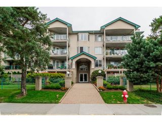 "Photo 1: 209 20443 53 Avenue in Langley: Langley City Condo for sale in ""COUNTRYSIDE ESTATES"" : MLS®# R2096431"