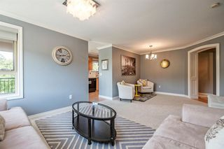 "Photo 8: 310 200 KLAHANIE Drive in Port Moody: Port Moody Centre Condo for sale in ""SALAL"" : MLS®# R2174958"