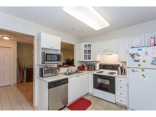 """Photo 9: 308 1190 EASTWOOD Street in Coquitlam: North Coquitlam Condo for sale in """"LAKE SIDE TERRACE"""" : MLS®# R2175674"""
