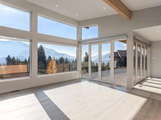 "Photo 3: 9 40781 THUNDERBIRD Ridge in Squamish: Garibaldi Highlands House for sale in ""Stonehaven"" : MLS®# R2220919"