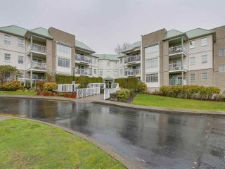 "Main Photo: 106 9767 140 Street in Surrey: Whalley Condo for sale in ""FRASER GATE"" (North Surrey)  : MLS®# R2225116"