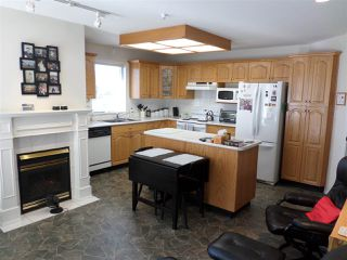 """Photo 3: 104 2626 COUNTESS Street in Abbotsford: Abbotsford West Condo for sale in """"THE WEDGEWOOD"""" : MLS®# R2248005"""