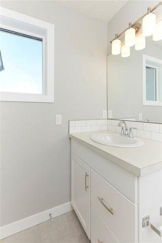 Photo 13: 1310 WALDEN Drive SE in Calgary: Walden Semi Detached for sale : MLS®# C4194452