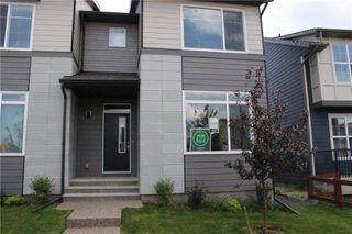 Photo 2: 1310 WALDEN Drive SE in Calgary: Walden Semi Detached for sale : MLS®# C4194452
