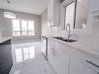 Photo 8: 4135 7 Avenue in Edmonton: Zone 53 House for sale : MLS®# E4159607
