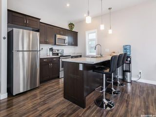 Photo 2: 219 Eaton Crescent in Saskatoon: Rosewood Residential for sale : MLS®# SK778067