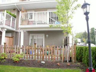 Photo 2: 23 5355 201A Street in Langley: Langley City Townhouse for sale : MLS®# F1104483