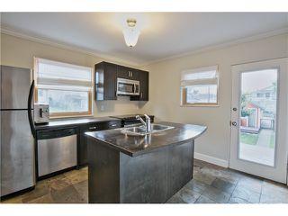 Photo 7: 2880 GRANT Street in Vancouver: Renfrew VE House for sale (Vancouver East)  : MLS®# V1055300