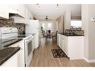 Photo 11: 81 COVEWOOD Close NE in Calgary: Coventry Hills House for sale : MLS®# C4014534