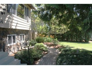 """Photo 2: 4794 206A Street in Langley: Langley City House for sale in """"City Park"""" : MLS®# F1445870"""
