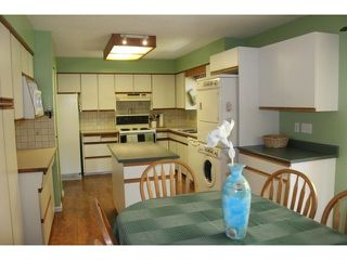 """Photo 4: 4794 206A Street in Langley: Langley City House for sale in """"City Park"""" : MLS®# F1445870"""