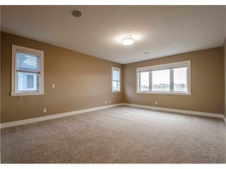 Photo 25: 30 STRATHRIDGE Park SW in Calgary: Strathcona Park House for sale : MLS®# C4111566
