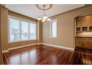 Photo 3: 30 STRATHRIDGE Park SW in Calgary: Strathcona Park House for sale : MLS®# C4111566