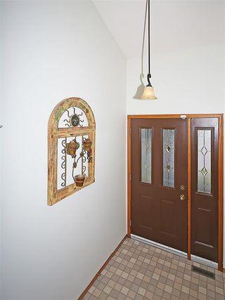 Photo 2: 359 HAWKCLIFF Way NW in Calgary: Hawkwood House for sale : MLS®# C4116388