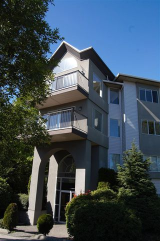 "Photo 1: 311 32725 GEORGE FERGUSON Way in Abbotsford: Abbotsford West Condo for sale in ""Uptown"" : MLS®# R2182713"