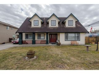 "Photo 1: 34610 5TH Avenue in Abbotsford: Poplar House for sale in ""Huntingdon Village"" : MLS®# R2344503"