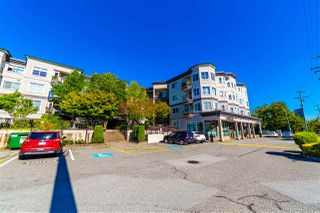 """Photo 1: 401 5765 GLOVER Road in Langley: Langley City Condo for sale in """"College Court"""" : MLS®# R2493254"""