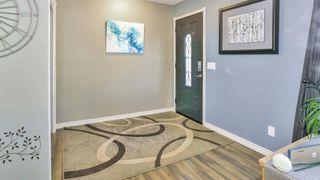 Photo 4: 164 Deermont Way SE in Calgary: Deer Ridge Detached for sale : MLS®# A1051814